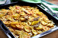 Potato dauphinoise. Close up of baked potato dauphinois in metal tray Stock Photography