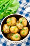 Potato with dill and scalliom Stock Photo
