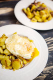 Potato dish with fried egg Royalty Free Stock Photo