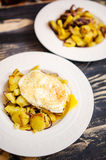 Potato dish with fried egg Stock Images