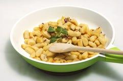 Potato dumplings on the green frying pan Royalty Free Stock Images