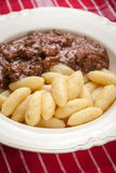 Potato dumplings with a sauce of beef. Stock Photography