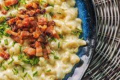 Potato dumplings with sheep cheese and bacon, traditional slovakian food, slovak gastronomy stock photography