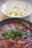 Potato dumplings  with tomato sauce Stock Image