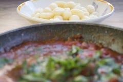 Potato dumplings  with tomato sauce Stock Images