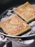 Potato Farls Frying in Butter Stock Images