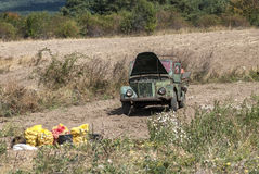 Potato field in the mountain. With freshly dug potatoes and old military vintage vehicle Stock Photo