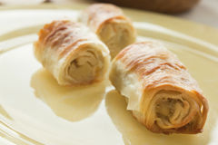 Potato filo pastry. With vegetables and cutlery in the back Royalty Free Stock Photo