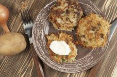 Potato flapjack (draniki). With sour cream Stock Photos