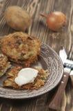 Potato flapjack (draniki). With sour cream Royalty Free Stock Image