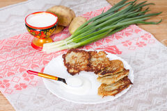 Potato flapjacks with sour cream Stock Photos