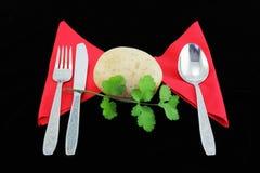 Potato with flatware. Stock Image