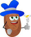 Potato flipping a coin Stock Images
