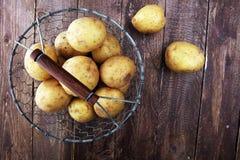 Potato food . Fresh raw organic potatoes. On old vintage background Royalty Free Stock Photography