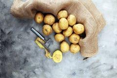 Potato food . Fresh raw organic potatoes. On old vintage background Stock Photos