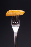 Potato and fork Stock Photography