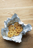 Potato fries in aluminium foil Stock Images