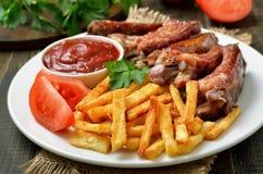Potato fries and pork ribs Royalty Free Stock Photos