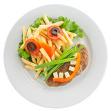 Potato fries with vegetables in shape of funny face Stock Images