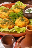 Potato fritter with sauce Stock Photography