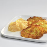 Potato fritters with apple sauce on plate Royalty Free Stock Photos