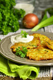 Potato fritters with cheese, green onion and herbs. Royalty Free Stock Photos
