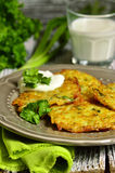 Potato fritters with cheese,  green onion and herbs. Royalty Free Stock Photography