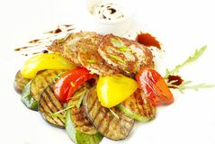 Potato fritters and grilled vegetables Royalty Free Stock Image