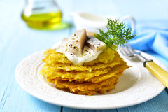 Potato fritters with herring. Stock Photo