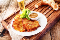 Potato fritters, pretzel and a beer Royalty Free Stock Photography