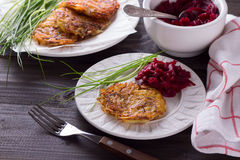 Potato fritters with red onion and spices, beet salad Stock Photo