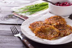 Potato fritters with red onion and spices Stock Photo