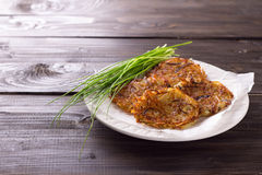 Potato fritters with red onion and spices Royalty Free Stock Images