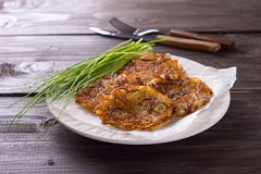 Potato fritters with red onion and spices Stock Photos