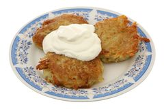Potato fritters with sour cream Stock Photos