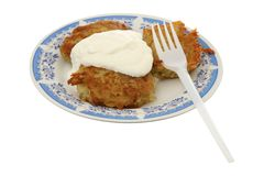 Potato fritters with sour cream Stock Photo