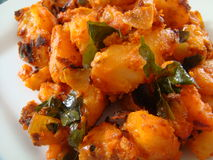 Potato fry. Potato curry/fry with herbs royalty free stock photography
