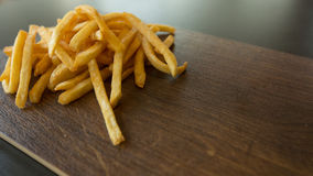 Potato fry on wood. Background Stock Photo