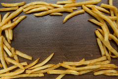 Potato fry on wood. Background Royalty Free Stock Images