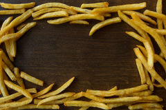 Potato fry on wood. Background Stock Images