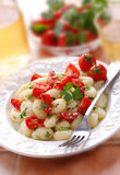 Potato gnocchi with cherry tomatoes Royalty Free Stock Photos