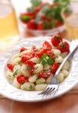 Potato gnocchi with cherry tomatoes Royalty Free Stock Photos