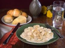 Potato gnocchi in creamy Alfredo sauce Stock Image