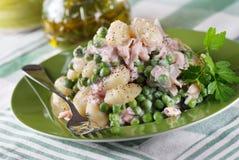 Potato gnocchi with ham and peas Stock Photo