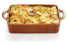 Potato gratin. Gratin dauphinois, french cuisine, on a white background royalty free stock images