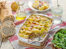 Potato gratin with bacon and cheese Stock Images