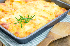 Potato gratin. In baking dish royalty free stock image