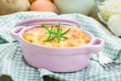 Potato gratin in ceramic cocotte Royalty Free Stock Photo
