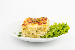 Potato gratin. Front view. Selective focus. White background stock images