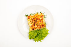 Potato gratin. Top view. Selective focus. White background stock images